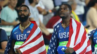 2016 Rio Olympics - Athletics - Final - Men's 4 x 100m Relay Final - Olympic Stadium - Rio de Janeiro, Brazil - 19/08/2016. Mike Rodgers (USA) of USA, Justin Gatlin (USA) of USA and Tyson Gay (USA) of USA after being disqualified.  REUTERS/Lucy Nicholson TPX IMAGES OF THE DAY. FOR EDITORIAL USE ONLY. NOT FOR SALE FOR MARKETING OR ADVERTISING CAMPAIGNS.
