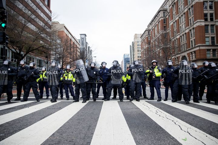 Police officers in riot gear stand lined up during a demonstration in Washington, D.C., after January's inauguration.
