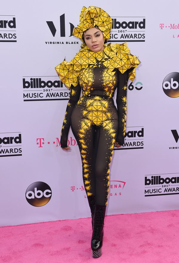 "Dencia really took the ""Go big or go home"" approach with this bold, futuristic look, which she wore to the Billboard Music Aw"