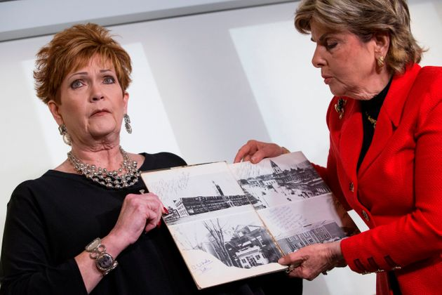 Attorney Gloria Allred (right) and Beverly Young Nelson hold up Nelson's high school yearbook at a press...