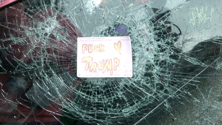 A destroyed car window in downtown Washington of a limo that was later set on fire following the inauguration of President Do