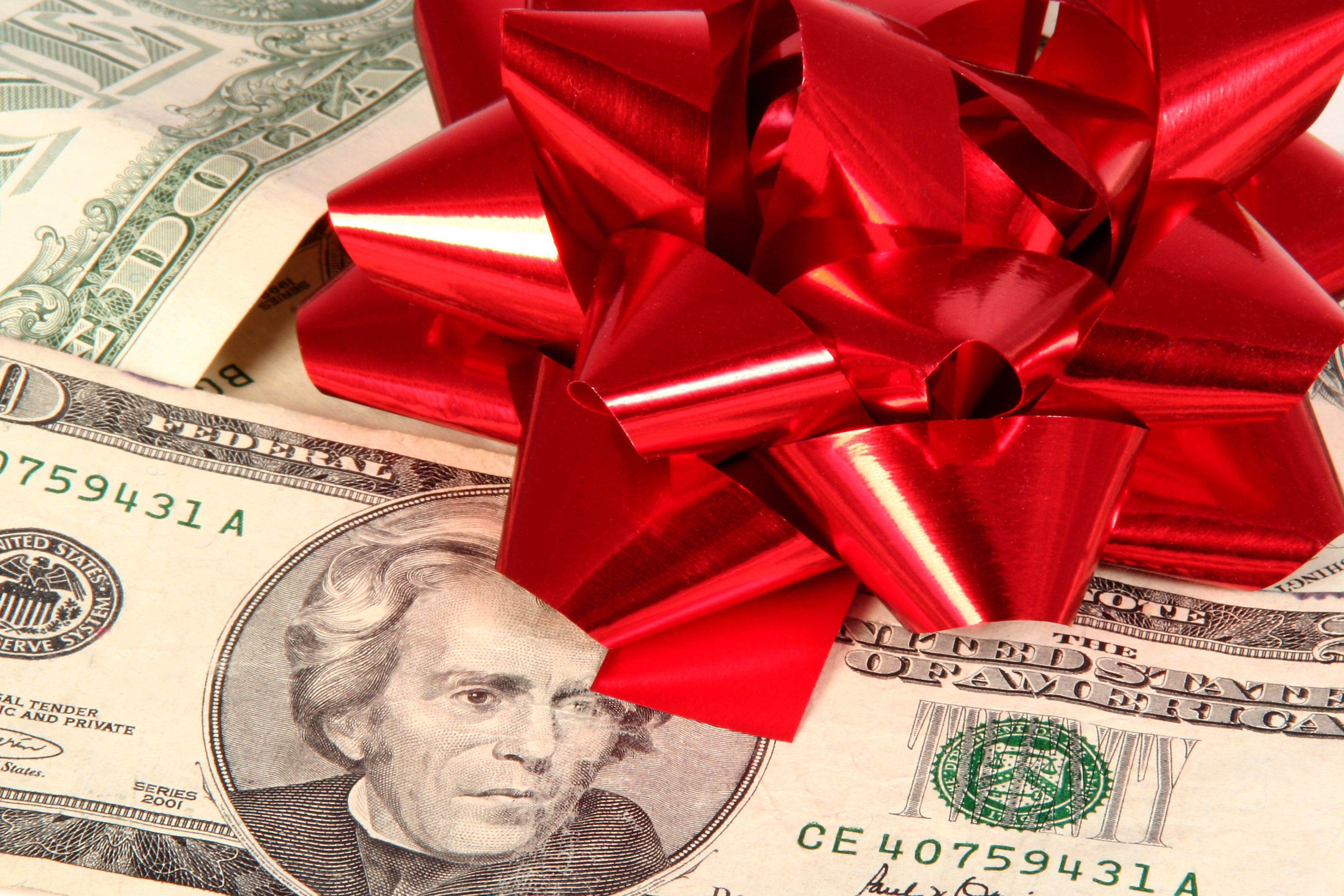 Christmas bow on money