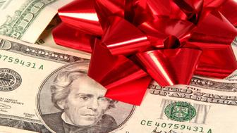 Christmas bow on money