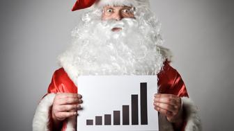 Santa Claus is holding a diagram in his hands.