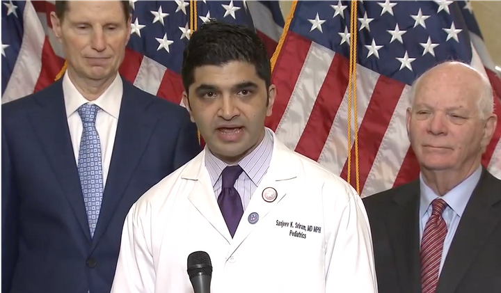 "<p>Dec 7, 2017: Sanjeev K Sriram, MD, MPH (aka <a rel=""nofollow"" href=""https://www.facebook.com/DrAmericaShow"" target=""_blank"">Dr America</a>), between Senator Ron Wyden and Senator Ben Cardin, speaking about the Republican tax bills' devastating impact on health care. </p>"