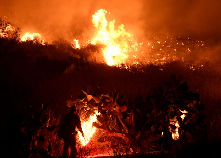Firefighters battle the Santa Ana wind-driven Thomas fire near Ventura, California, on Dec. 5, 2017.