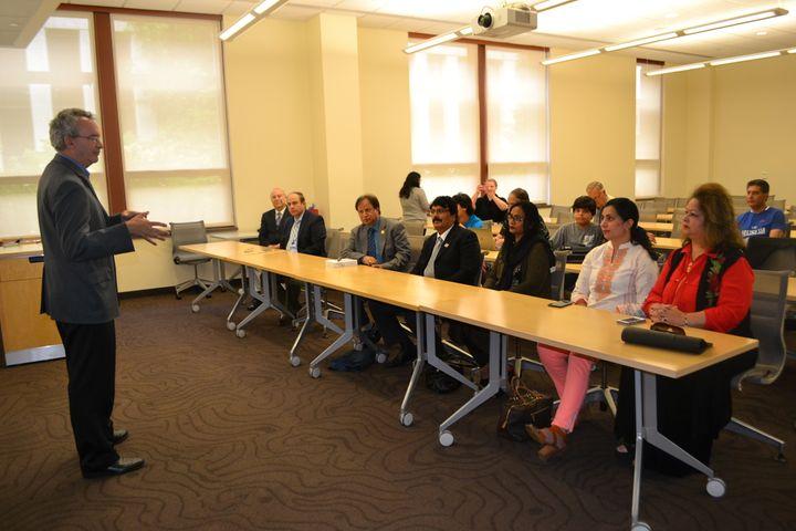 Then-School of International Service Dean James Goldgeier welcomes the Cholistan Development Council to American University f