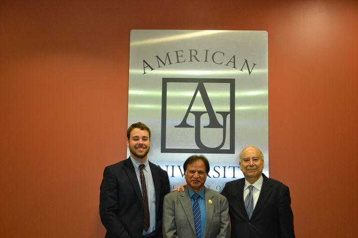 From left, Patrick Burnett, Dr. Zulfiqar Kazmi, and Ambassador Akbar Ahmed (author) gather at American University honoring th
