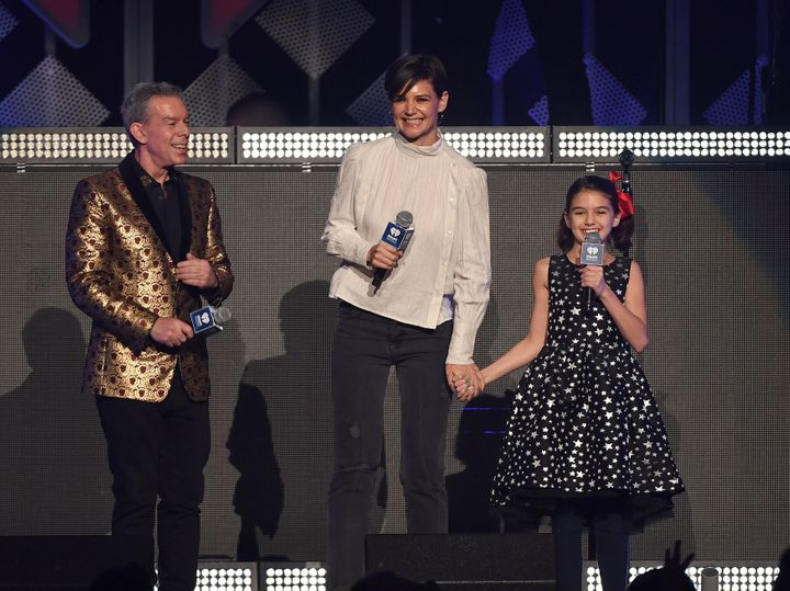 Radio host Elvis Duran, Katie Holmes and Suri Cruise onstage at Z100's iHeartRadio Jingle Ball 2017 on Dec. 8, 2017.