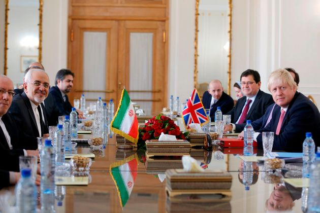 Iran's Foreign MinisterMohammad Javad Zarif (2nd left) meets with Johnson (right) in Tehran on