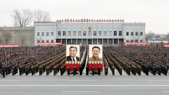 People rally to hail the completion of the state nuclear force, the cause of building a rocket power under the guidance of the Workers' Party of Korea, in this in this undated photo released by North Korea's Korean Central News Agency (KCNA) on December 6, 2017. KCNA/via REUTERS    ?ATTENTION EDITORS - THIS PICTURE WAS PROVIDED BY A THIRD PARTY. REUTERS IS UNABLE TO INDEPENDENTLY VERIFY THE AUTHENTICITY, CONTENT, LOCATION OR DATE OF THIS IMAGE. NO THIRD PARTY SALES. SOUTH KOREA OUT.