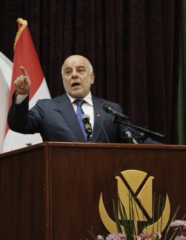 Haider al-Abadi delivers a speech during an international media conference in