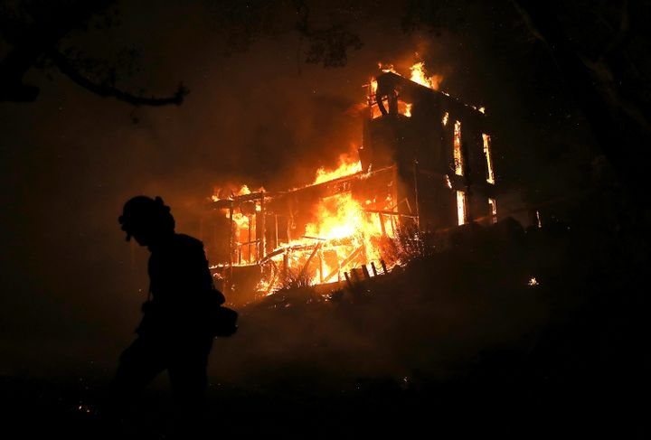 A home is consumed by fire in Ojai, California, on Dec. 7.