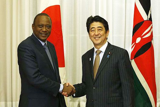<em>President Kenytta and Prime Minister Abe shake hands during TICAD in Nairobi in September 2016. Universal Health Coverage