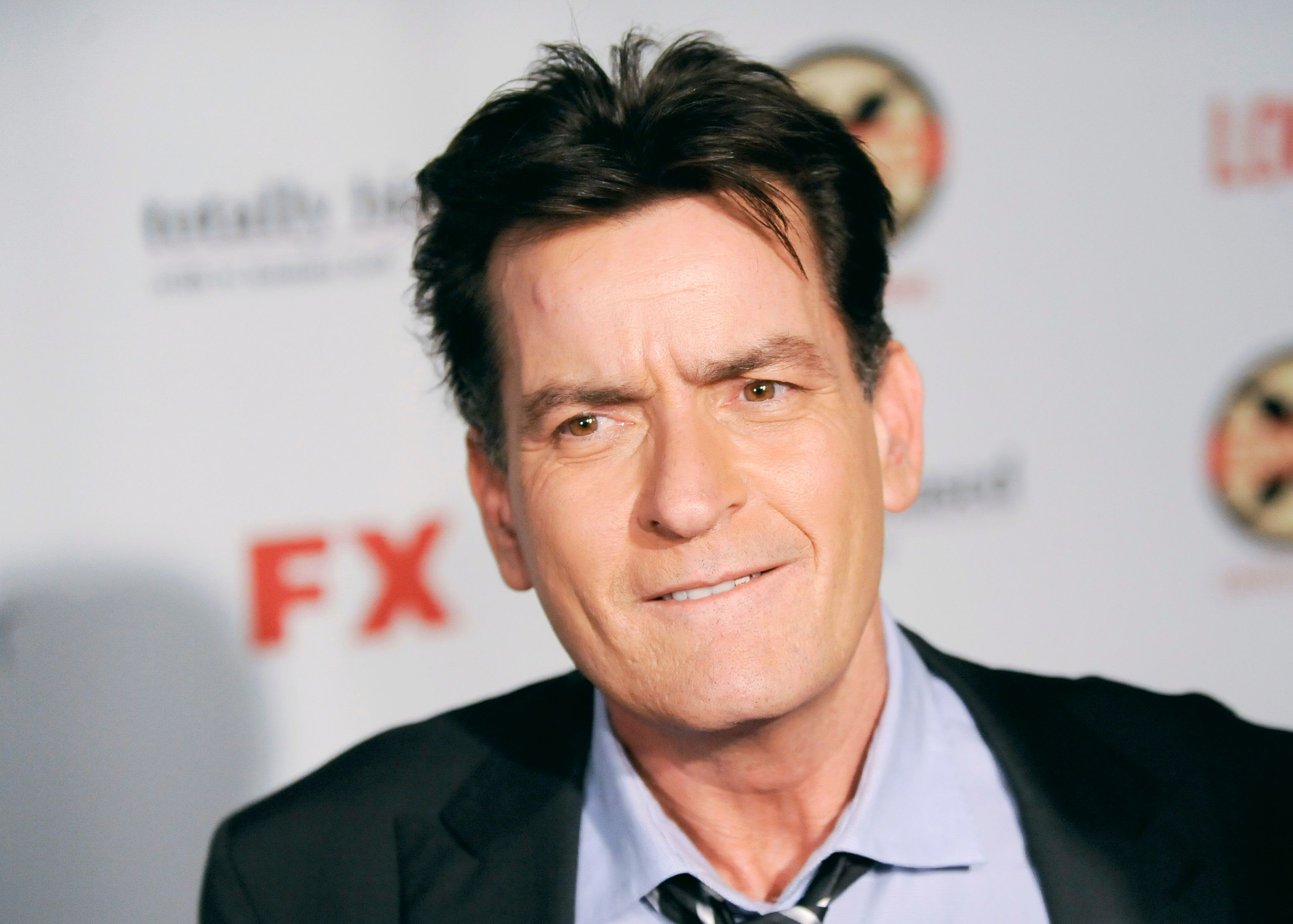 Actor Charlie Sheen arrives at the Hollywood FX Summer Comedies Party in Los Angeles, California June 26, 2012. REUTERS/Gus Ruelas (UNITED STATES - Tags: ENTERTAINMENT HEADSHOT)