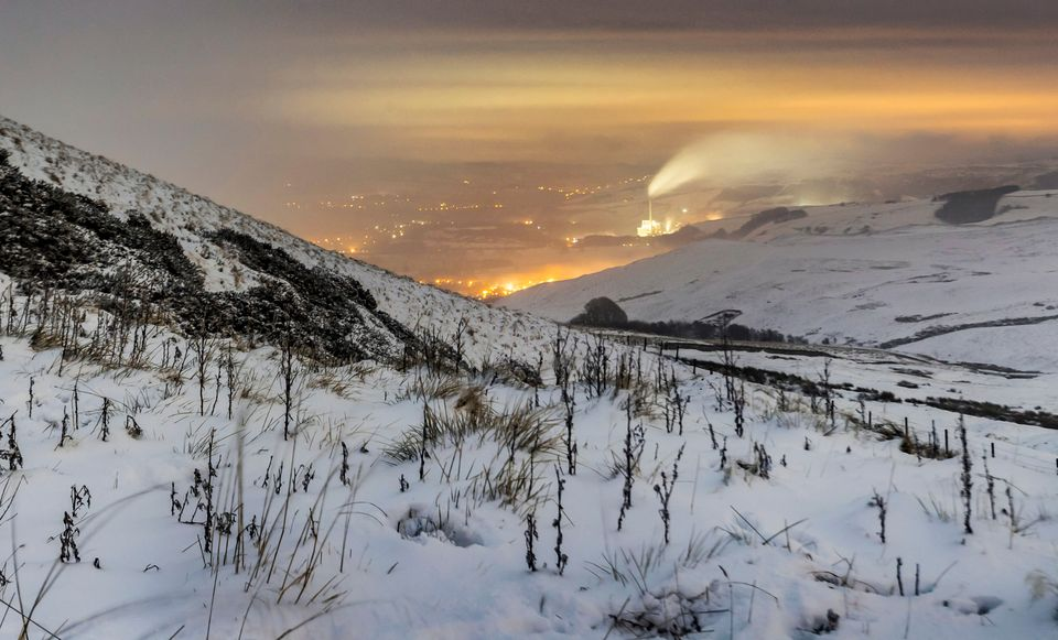 Snow covers Hope Valley in the Peak District at sunrise on Sunday