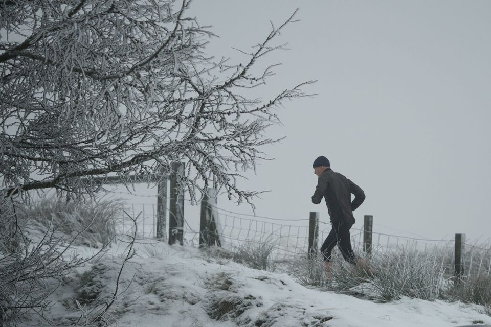 One man braved a morning run on Sunday amid snow-covered hills in Greater