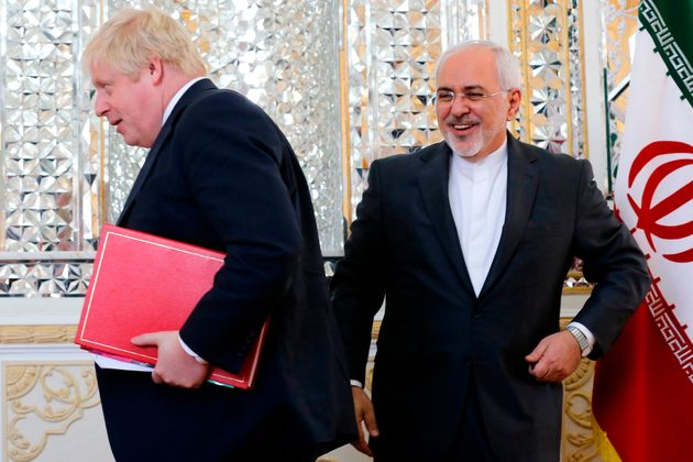 Boris Johnson, seen here with the country's foreign minister, has ended his Iran trip without...