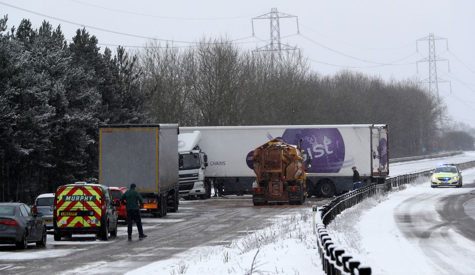 A lorry crashed on the busy A50 amid snow near Uttoxeter, Staffordshire, on