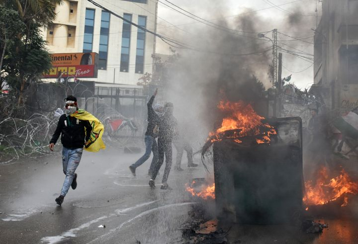 Demonstrators burn garbage container during a protest against U.S. President Donald Trump's announcement to recognize Jerusal