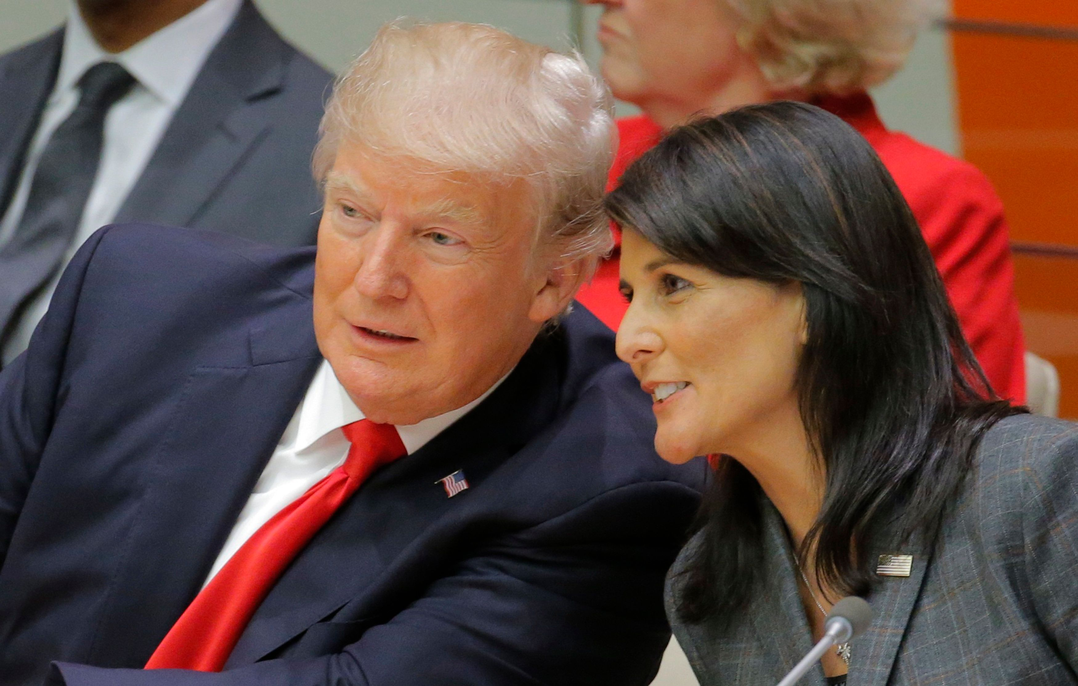 U.S. President Donald Trump talks with U.S. Ambassador to the U.N. Nikki Haley as they attend a session on reforming the United Nations at U.N. Headquarters in New York, U.S., September 18, 2017. REUTERS/Lucas Jackson