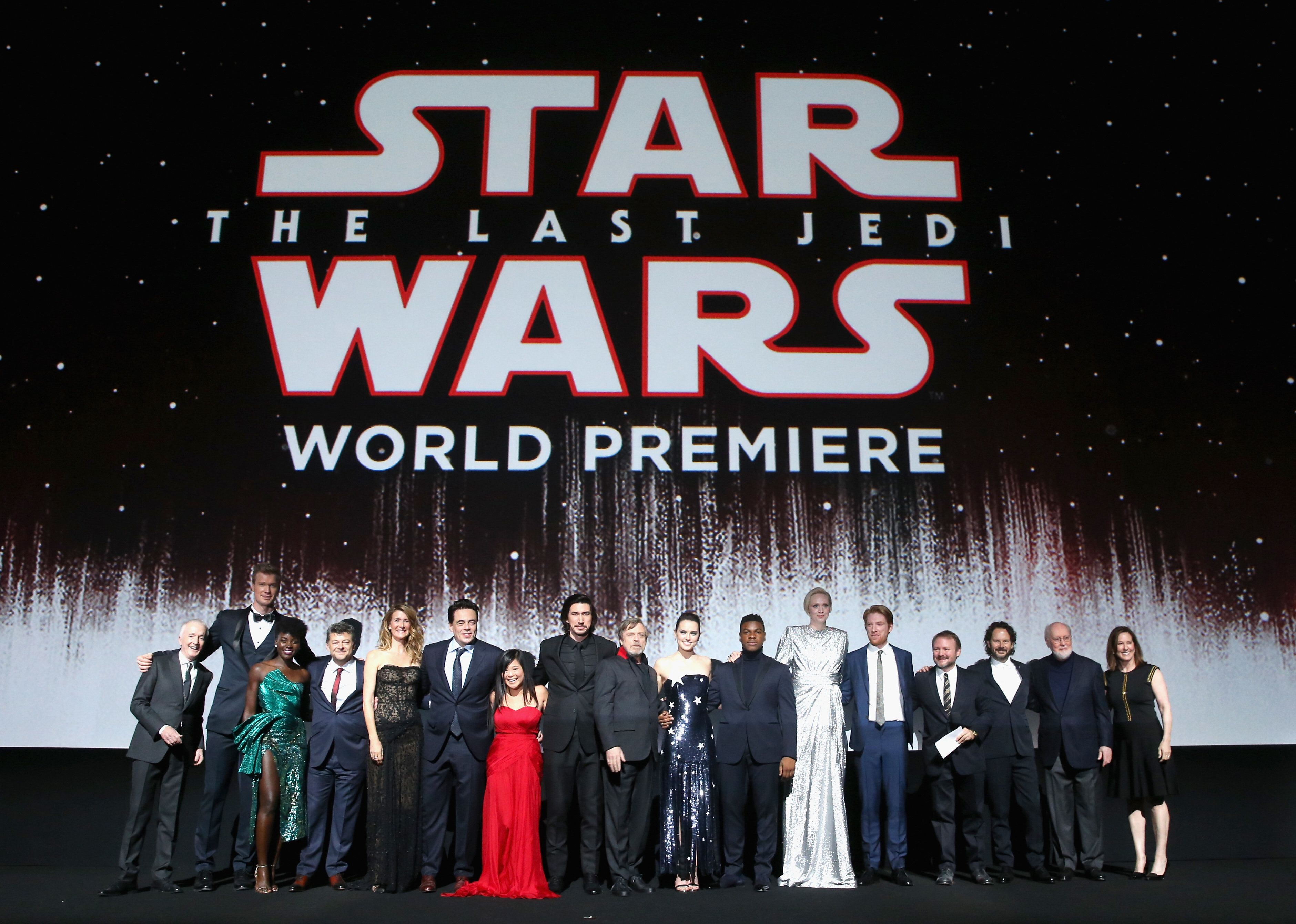 LOS ANGELES, CA - DECEMBER 09:  (L-R) Actors Anthony Daniels, Joonas Suotamo, Lupita Nyong'o, Andy Serkis, Laura Dern, Benicio del Toro, Kelly Marie Tran, Adam Driver, Mark Hamill, Daisy Ridley, John Boyega, Gwendoline Christie, Domhnall Gleeson, Writer/Director Rian Johnson, Producer Ram Bergman, Composer John Williams and Producer Kathleen Kennedy at Star Wars: The Last Jedi Premiere at The Shrine Auditorium on December 9, 2017 in Los Angeles, California.  (Photo by Jesse Grant/Getty Images for Disney)
