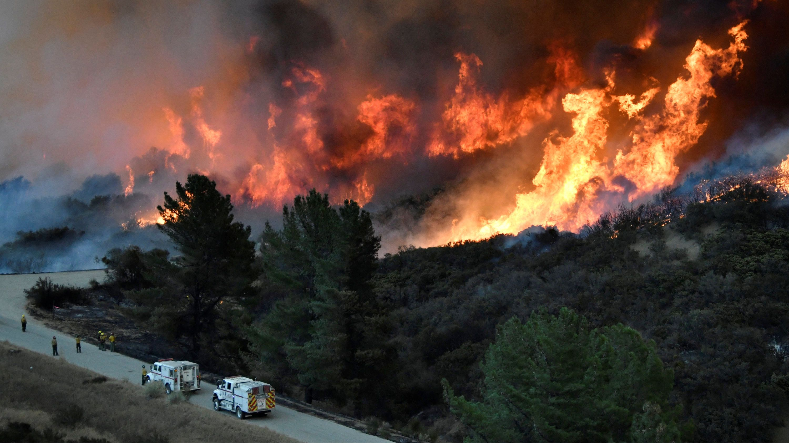California Firefighters Try To Contain Rapidly Spreading Wildfires
