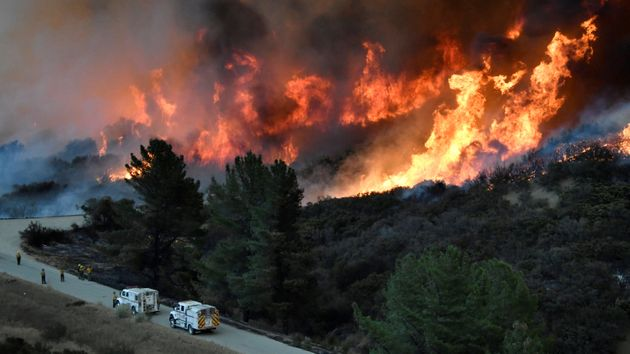 Fire fighters attack the Thomas fire's north flank with backfires as they continue to fight a massive...