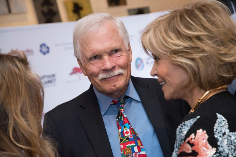Environmentalist and media mogul Ted Turner talks with actor Jane Fonda, right, and others on the green carpet during the Cap