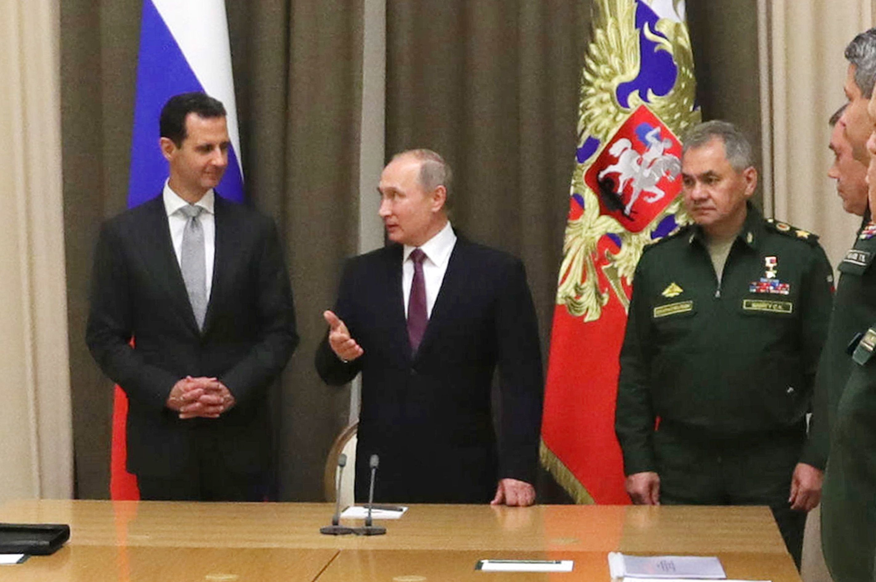 SOCHI, RUSSIA - NOVEMBER 21, 2017: Syria's President Bashar al-Assad, Russia's President Vladimir Putin, and Russia's Defence Minister Sergei Shoigu (L-R) during a meeting at Bocharov Ruchei residence. Mikhail Klimentyev/Russian Presidential Press and Information Office/TASS (Photo by Mikhail Klimentyev\TASS via Getty Images)