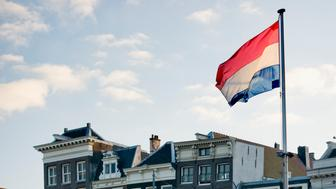 The Netherlands' flag waves in the wind in the city of Amsterdam.