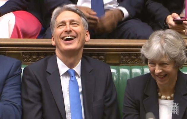 Chancellor Philip Hammond alongside Theresa May in the House of