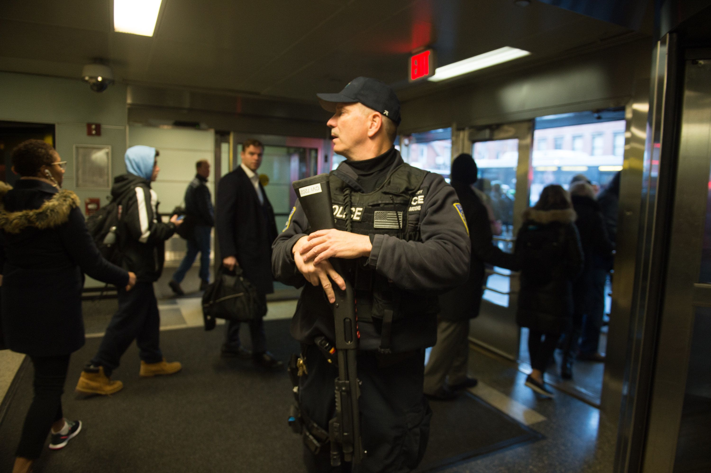 Port Authority Police watch as people evacuate after a reported explosion at the Port Authority Bus Terminal on December 11, 2017 in New York.  New York police said Monday that they were investigating an explosion of 'unknown origin' in busy downtown Manhattan, and that people were being evacuated. Media reports said at least one person had been detained after the blast near the Port Authority transit terminal, close to Times Square.Early media reports said the blast came from a pipe bomb, and that several people were injured.  / AFP PHOTO / Bryan R. Smith        (Photo credit should read BRYAN R. SMITH/AFP/Getty Images)