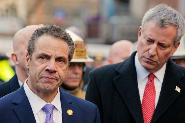 New York Mayor Bill de Blasio (R) looks on as New York governor Andrew Cuomo speaks at the press conference...