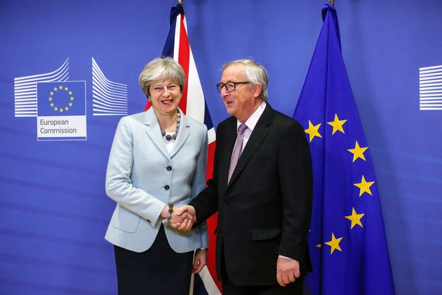 Theresa May shakes hands with European Commission President Jean-Claude