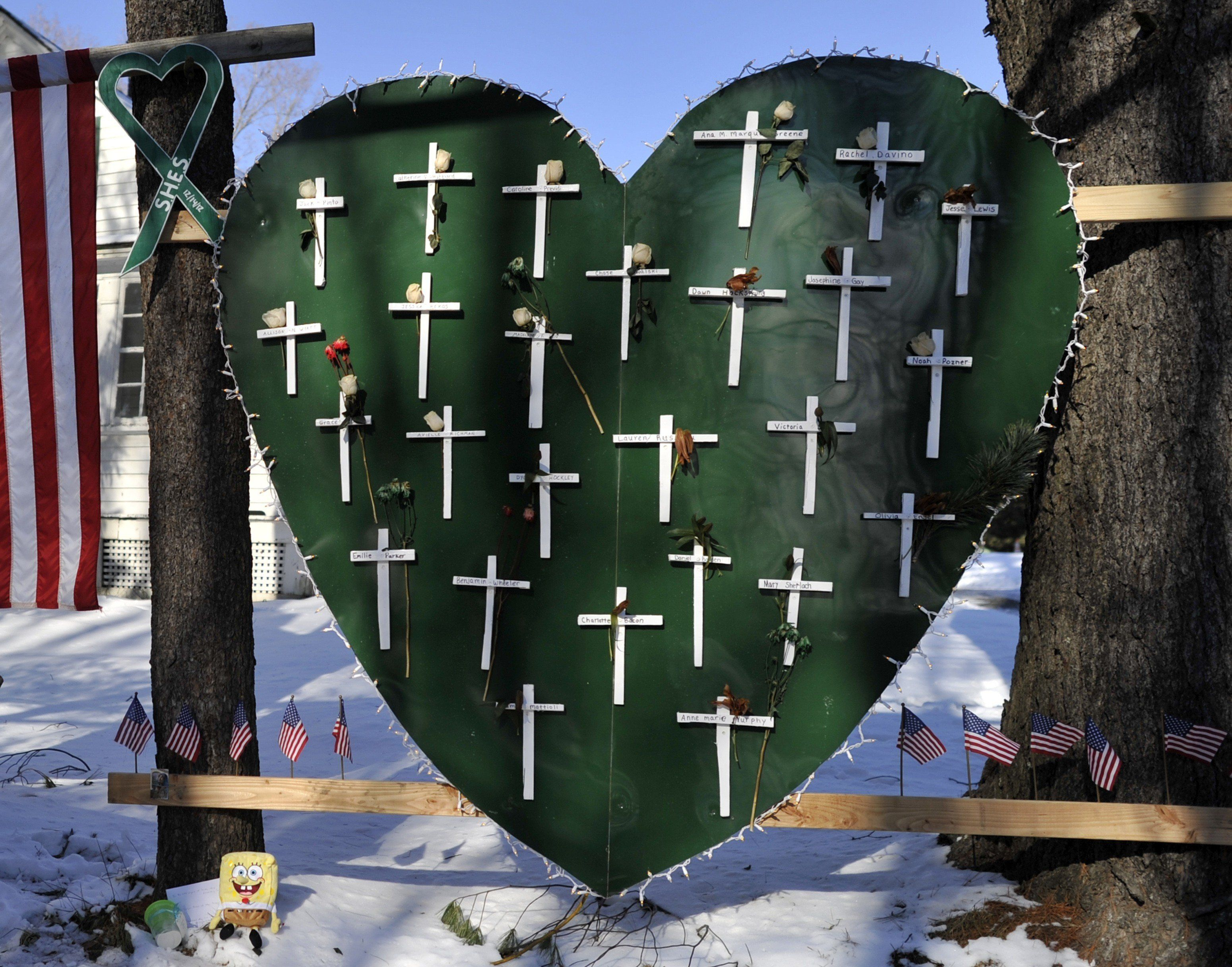 Some of the remaining memorial items to  Sandy Hook Elementry students and staff who died are viewed in Newtown, Connecticut on January 3, 2013.  Students at the elementary school where a gunman massacred 26 children and teachers last month were returning Thursday to classes at an alternative campus described by police as 'the safest school in America.' Survivors were finally to start their new academic year in the nearby town of Monroe, where a disused middle school has been converted and renamed from its original Chalk Hill to Sandy Hook. AFP PHOTO / TIMOTHY A. CLARY / AFP / TIMOTHY A. CLARY        (Photo credit should read TIMOTHY A. CLARY/AFP/Getty Images)