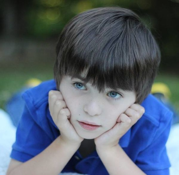 "Dylan Hockley, 6, loved to cuddle and adored his big brother. His parents established <a href=""http://www.dylanswingsofchange"