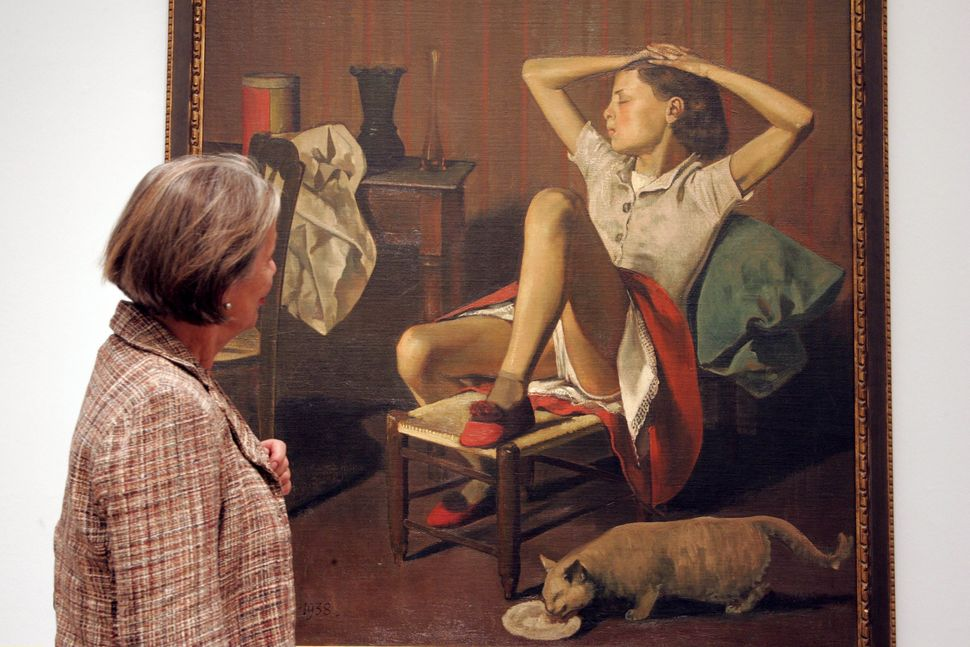 "A woman looks at Balthus' ""Thérèse Dreaming."""