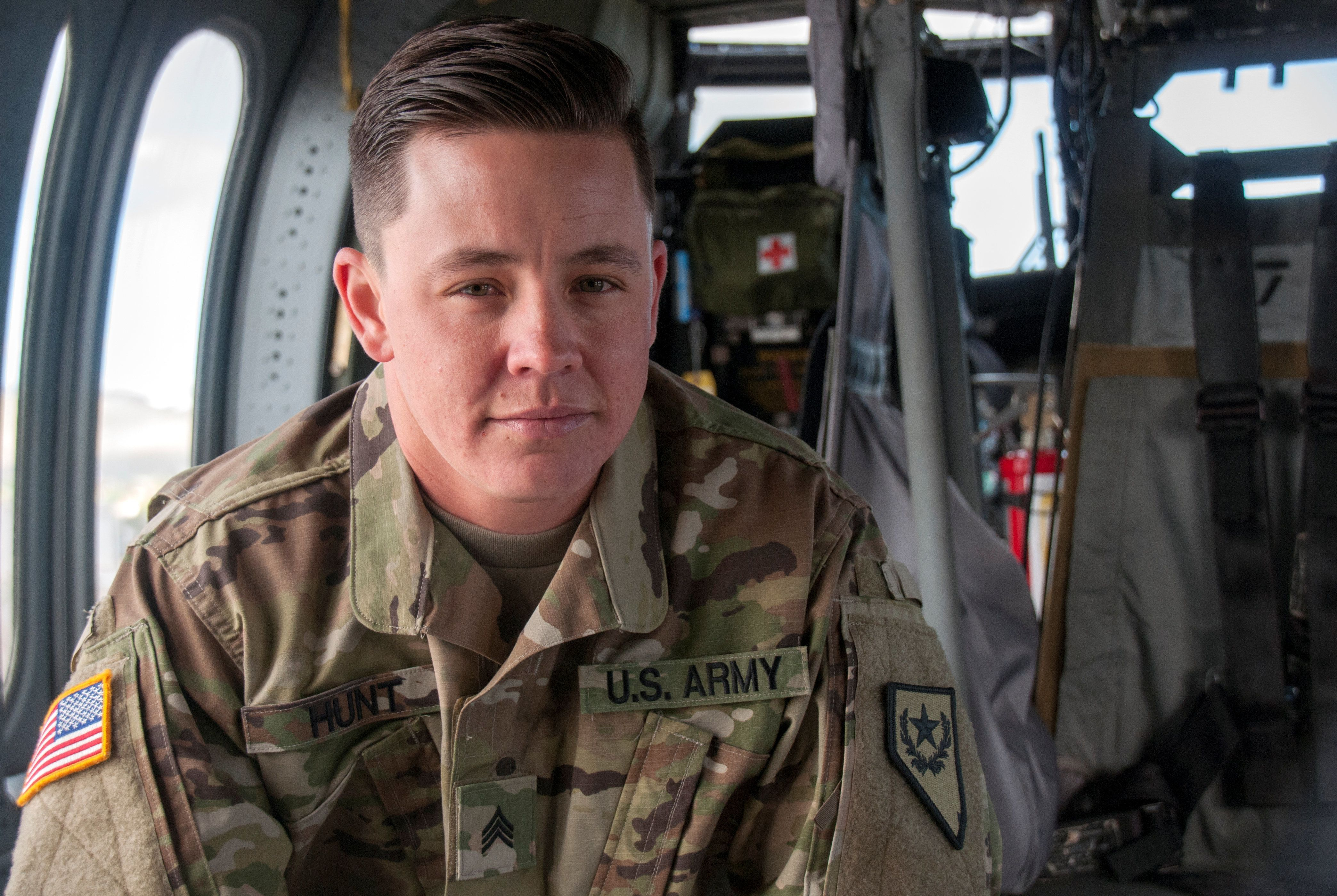 Nevada Army National Guard Sergeant Sam Hunt, an electrician with G Company, 2/238th General Support Aviation Battalion poses for a photo on the flight line at the Army Aviation Support Facility in Stead, Nevada, U.S. May 12, 2017. Hunt is the first openly transgender soldier of the Nevada National Guard. Picture taken May 12, 2017. Tech. Sgt. Emerson Marcus/Nevada Joint Force Headquarters Public Affairs/Handout via REUTERS.  ATTENTION EDITORS - THIS IMAGE WAS PROVIDED BY A THIRD PARTY.