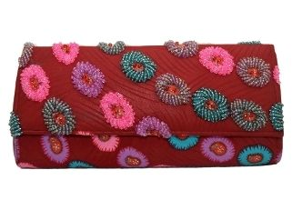 A timeless piece, this clutch features intricate details such as hand-sewn beads.