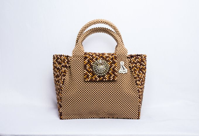<em>A neutral purse in different shades of brown and gold embellished with a touch of silver exudes effortless  glamour.</em>