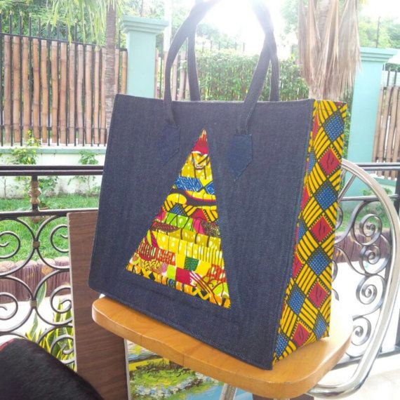Denim, prints and color lend this tote an exotic appeal. Definitely a must-have piece !