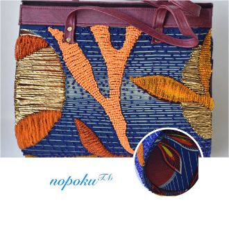 <em>This is an iconic over-sized bag embezzled with pieces of recycled beads hand stitched onto its&#39; front and back secti