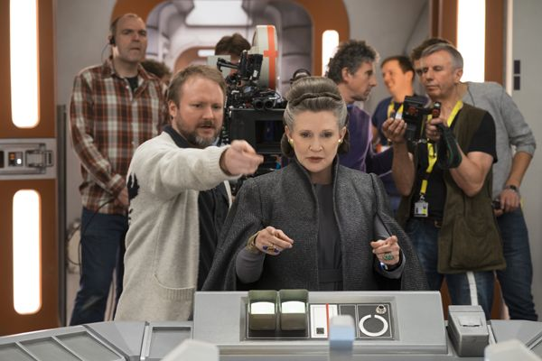 L to R: Director Rian Johnson with Carrie Fisher (Leia) on set.