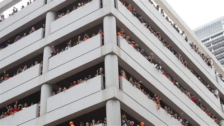 Astros fans watch from a parking garage during a parade honoring the World Series champions in Houston. The rise of ride-hail