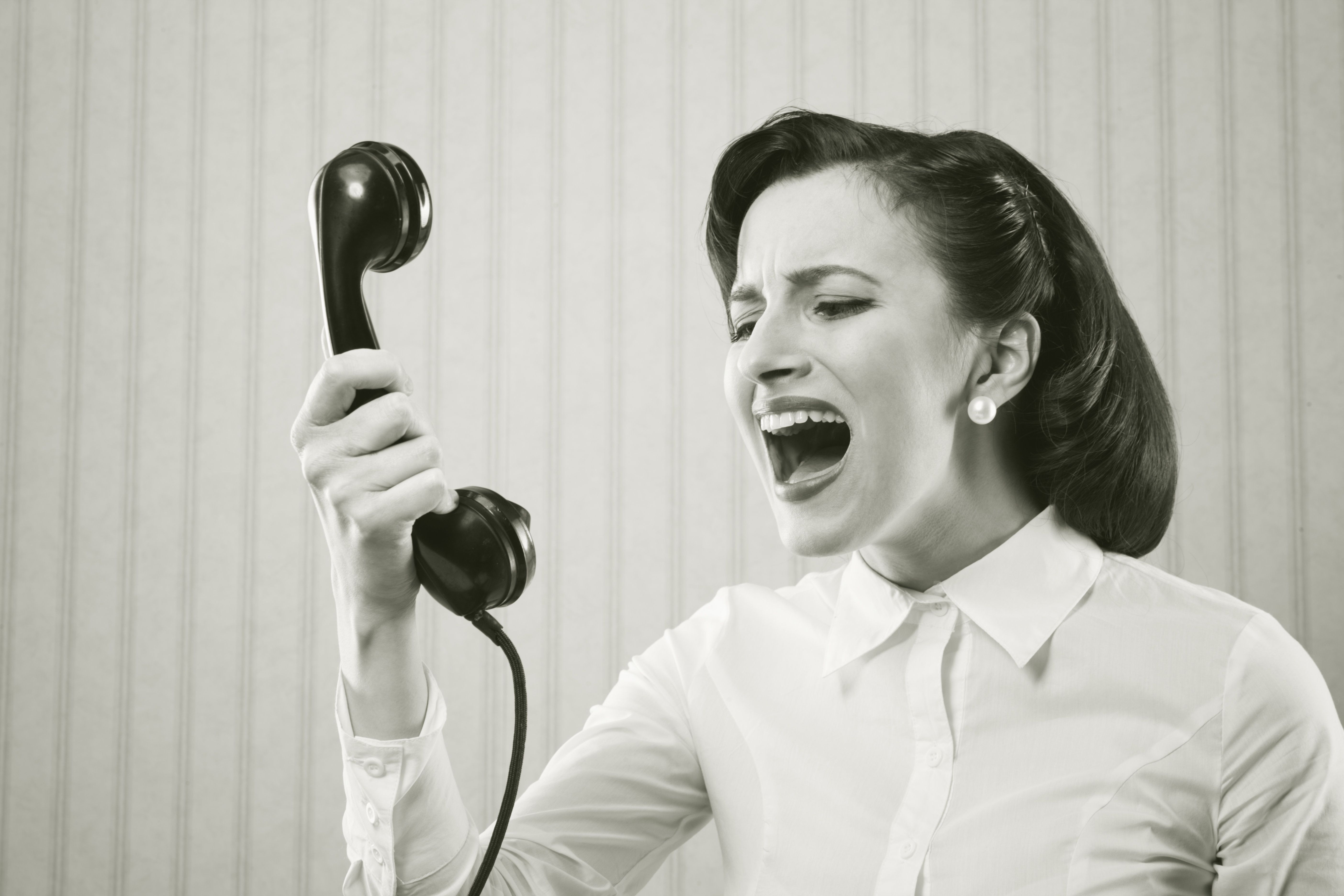 Young Woman shouting into telephone