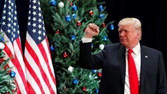 U.S. President Donald Trump pumps his fist after speaking about tax reform legislation during a visit to St. Louis, Missouri, U.S. November 29, 2017. REUTERS/Kevin Lamarque