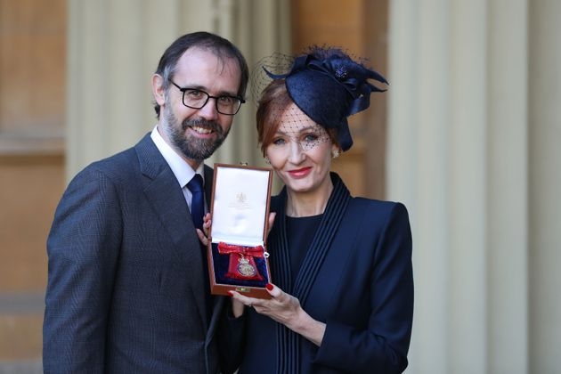 J.K. Rowling, accompanied by her husband Neil Murray, poses with her