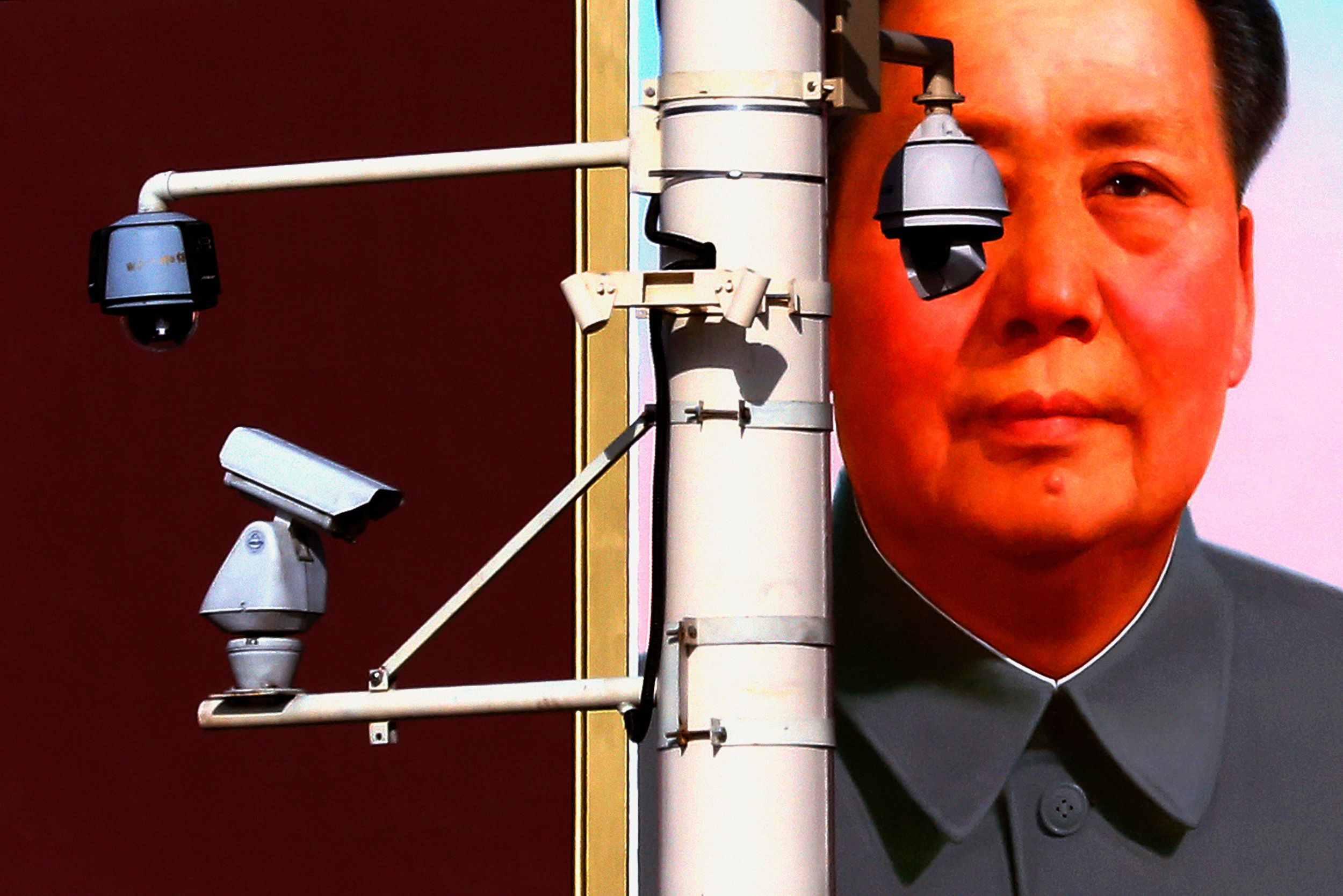 Security cameras are attached to a pole in front of the giant portrait of former Chinese Chairman Mao Zedong on Beijing's Tiananmen Square, near the Great Hall of the People where the 18th National Party Congress (NPC) is currently being held, November 11, 2012.     REUTERS/David Gray     (CHINA - Tags: SOCIETY POLITICS CIVIL UNREST TPX IMAGES OF THE DAY)
