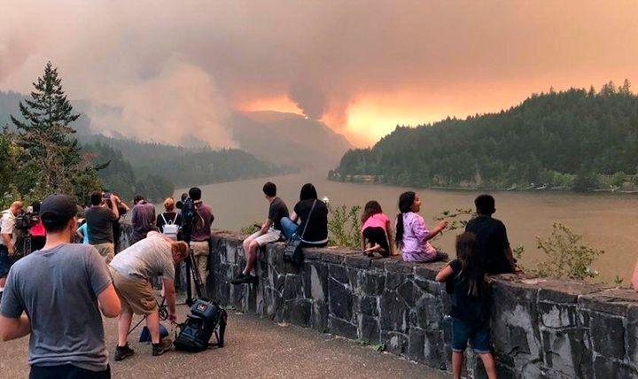Bystanders watch the Eagle Creek fire burn in Oregon on September 4, 2017.